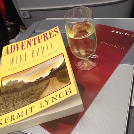 Flight from Atlanta to Paris with a glass of Champagne, of course! And an excellent book detailing importer Kermit Lynch and his travels around wine country in France - a must-read to prepare for the journey.